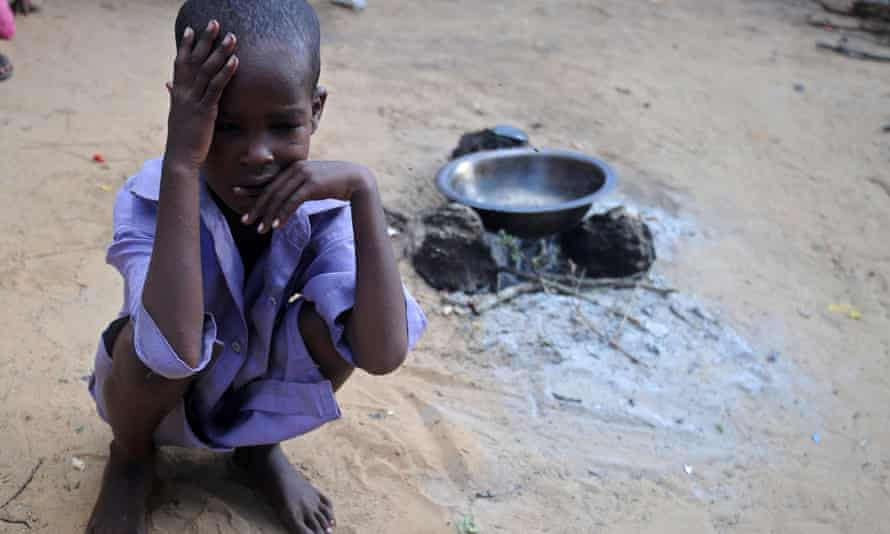 A Somali child sits at a makeshift camp on the outskirts of Mogadishu