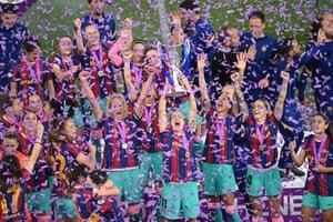 Barcelona's players raise their trophy.