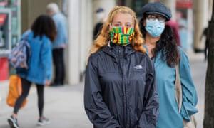 People wearing masks in London.