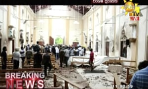This image made from video provided by Hiru TV shows damage inside a church after a blast in Colombo.
