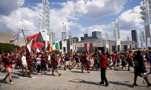 Atlanta United fans marching to the stadium together.