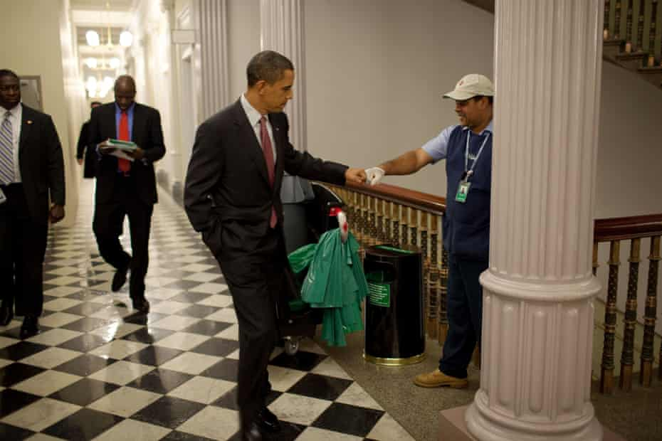 Obama fist-bumps custodian Lawrence Lipscomb in the White House in 2009.