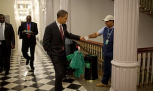 Obama greets custodian Lawrence Lipscomb in the Eisenhower Executive Office Building, 3 Dec 2009.