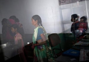 Women who underwent sterilisation surgery queue to receive food inside a hospital in the eastern Indian state of Chhattisgarh, in November 2014