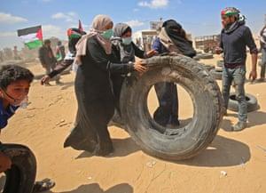 Women roll a tyre