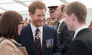 Prince Harry meets guests at the reception.