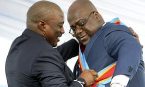 Felix Tshisekedi receives the presidential sash from Joseph Kabila