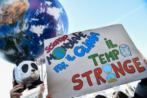 Rome, Italy: students hold a papier-mache panda, an inflatable Earth and a placard reading 'Time is running out'