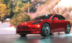 A Tesla Model 3 sedan, its first car aimed at the mass market, is displayed during its launch in Hawthorne, California.