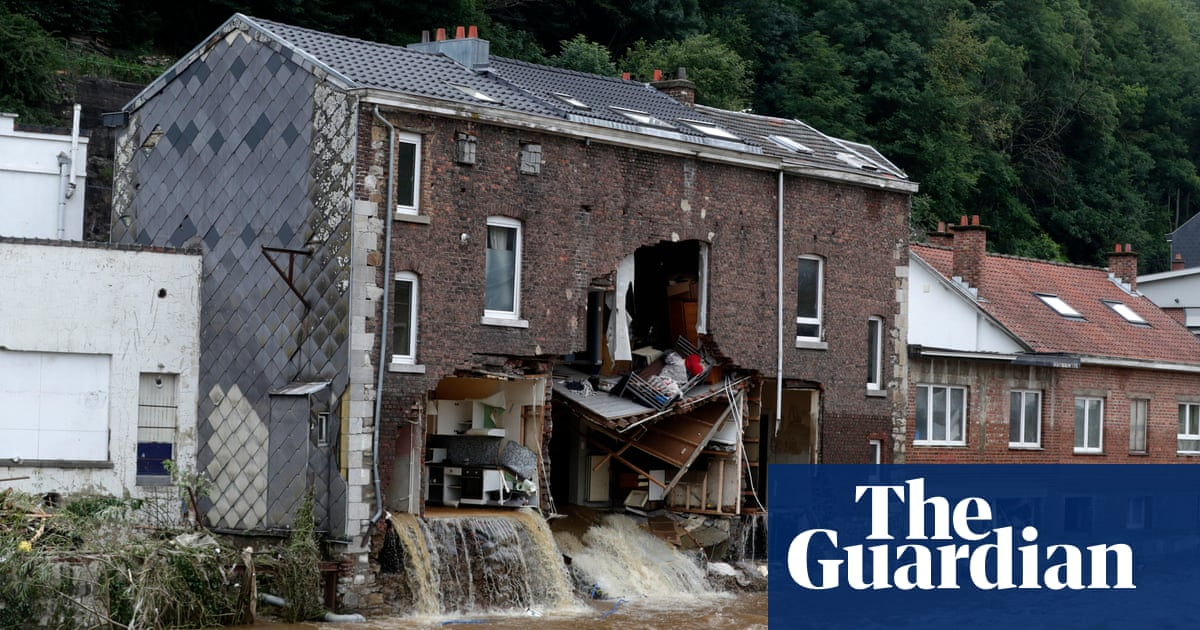 Belgian news crew capture moment flooded house partially collapses – video