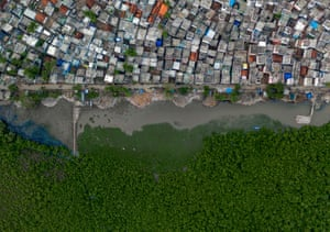 Houses on the edge of Kakinada city reach the estuary, buffered from the sea by the remains of a mangrove swamp.