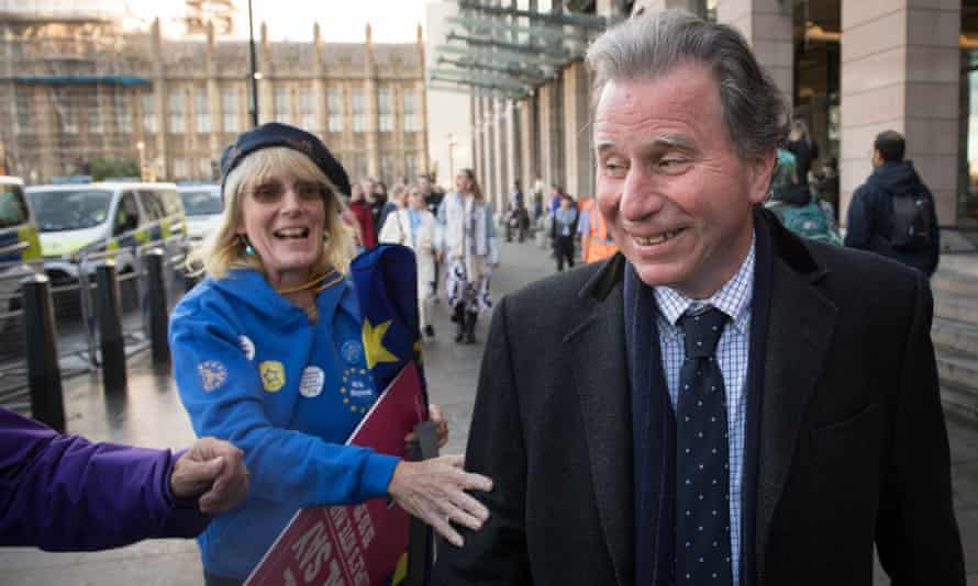 Oliver Letwin is congratulated by anti-Brexit activists in Parliament Square, London, after his amendment was passed in the Commons.