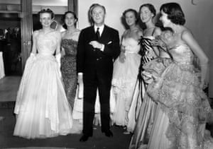 Couturier Christian Dior – designer of the 'New Look' and the 'A-line' – with six of his models after a fashion parade at the Savoy Hotel, London.