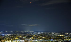 Oslo during a rare astronomical event when a swollen 'supermoon' and lunar eclipse combined for the first time in decades.