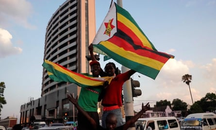Zimbabweans cheering Mugabe's resignation in November.