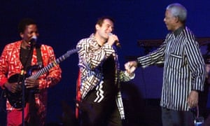 Johnny Clegg, centre, on stage with his band Juluka and the former South African president Nelson Mandela in Frankfurt in 1999. One of Clegg's best-known songs, Asimbonanga, was a tribute to Mandela.