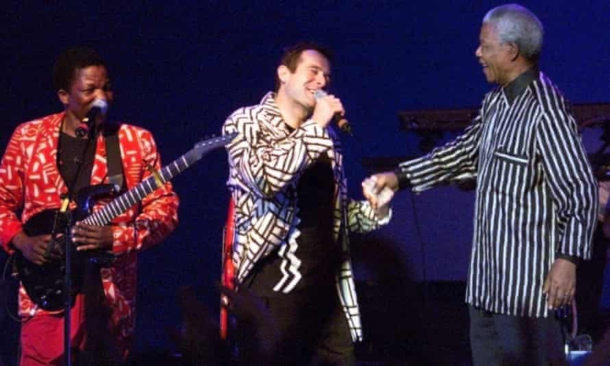 Nelson Mandela, right, with South African singer Johnny Clegg during a concert in Frankfurt in 1999.