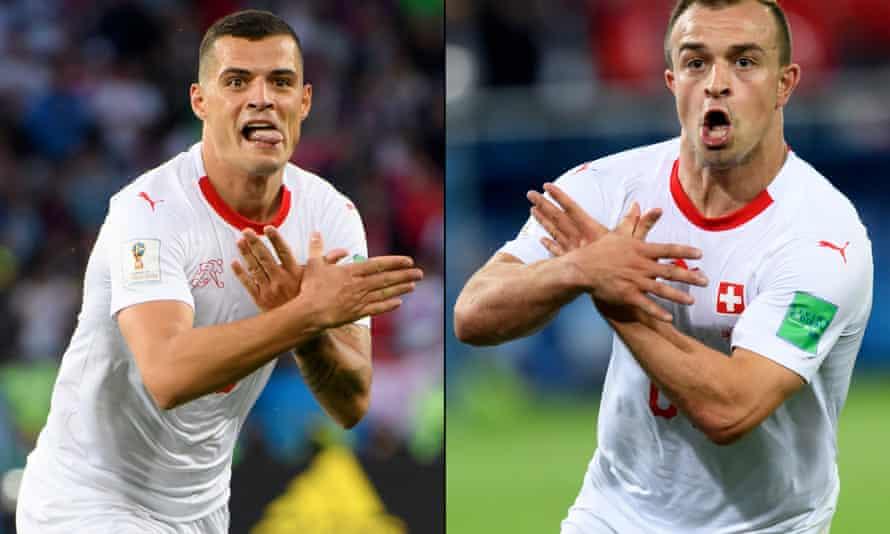 Granit Xhaka and Xherdan Shaqiri celebrate their goals against Serbia.
