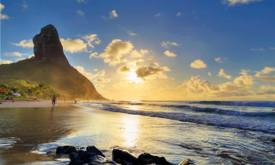 Fernando de Noronha, with Morro Pico mountain in the background, is a spectacular chain of 21 islands, islets and volcanic outcrops in the Atlantic Ocean.