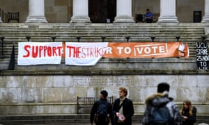 A banner at University College London. University lecturers and support staff recently took part in a strike over pensions and pay