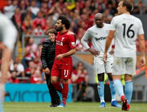 Salah with the young pitch invader.