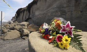 Flowers lies on debris from Friday's cliff collapse at Grandview beach near San Diego in which three women were killed.
