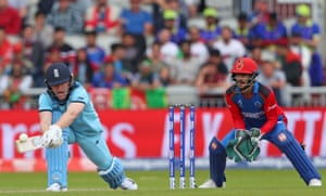 Eoin Morgan of England plays a reverse sweep and picks up 18 off the over.