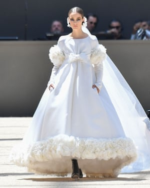 A voluminous feather-trimmed bridal gown.