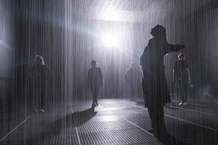 People move through the 100 sq m field of continuous rainfall.