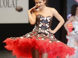 Host Karima Charni in a chocolate-studded dress.