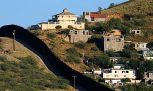 Buildings in Nogales, Mexico, are separated by a border fence from Nogales, Arizona.