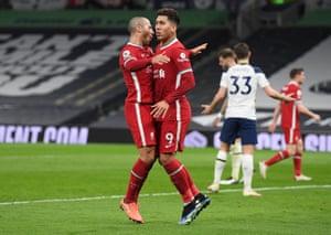 Thiago Alcantara congratulates Roberto Firmino.