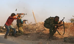 Fighters from the Free Syrian Army take part in a battle against Islamic State jihadists in the northern Syrian village of Yahmoul