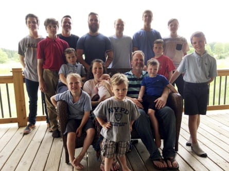 The Schwandt family at their farm in Lakeview, Michigan, in 2018. Standing from left are Tommy, Calvin, Drew, Tyler, Zach, Brandon, Gabe, Vinny and Wesley. Seated, starting at upper left are Charlie, Luke, mother Kateri holding Finley, father Jay with Tucker and Francisco in the foreground.