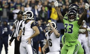 Greg Zuerlein (4) and Seattle Seahawks free safety Tedric Thompson (33) react after the kicker's missed field goal decides the game