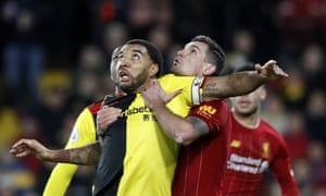 Troy Deeney of Watford is manhandled by Dejan Lovren of Liverpool but nothing was given.