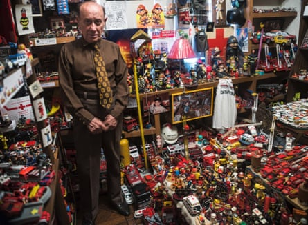 Surrounded by clutter … Metinides at home in his modest Mexico City apartment.