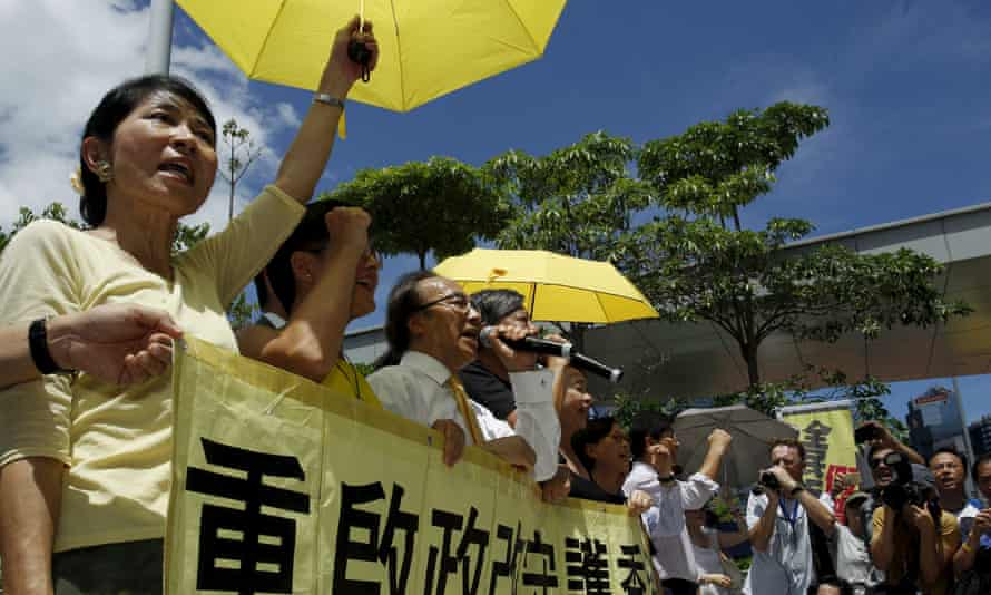 Claudia Mo, left, and other pro-democracy politicians demonstrate in Hong Kong in June.