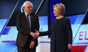 Bernie Sanders and Democratic presidential candidate Hillary Clinton shake hands.