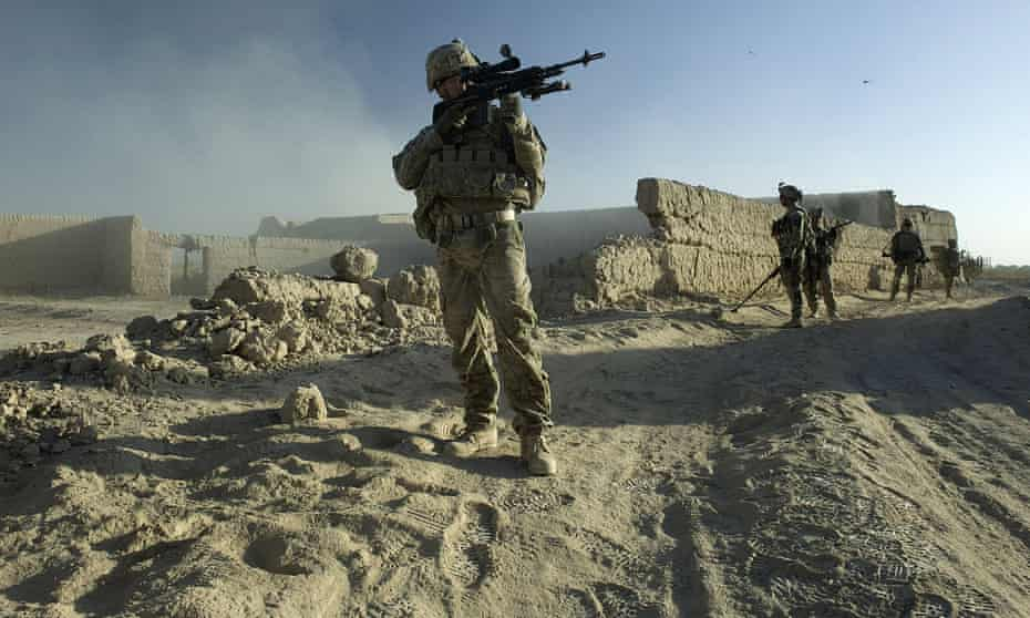 A US army marksman scopes for ambushes in Panjwai district, Afghanistan on 23 September 2012.