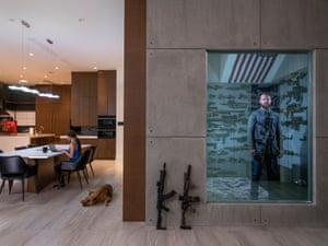 Robert Baldwin Jr stands in his secret gunroom, behind a one-way mirror in his home in Las Vegas, Nevada, USA, on 16 April 2019