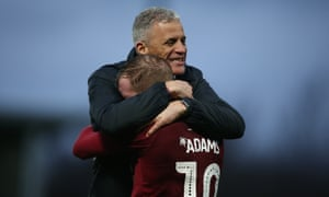 Keith Curle and Nicky Adams celebrate Northampton's third-round win at Derby.