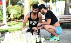Jose Alves and Tony Bracamonte at a Vigil for victims of the Orlando shooting LA Pride parade, Los Angeles, 12 June 2016.
