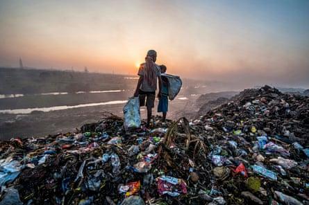 Children looking through rubbish on landfill site in Calcutta