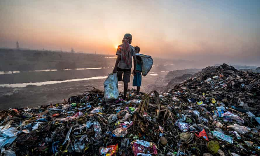 Children looking through rubbish on landfill siteCalcutta (Kolkata), India. Neoliberal policies have led to social and environmental failures.