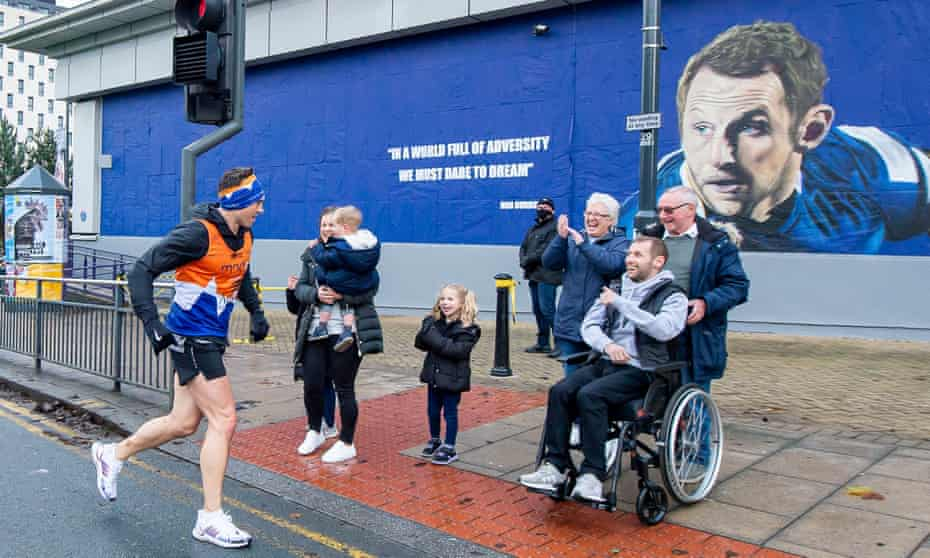 Kevin Sinfield greets Rob Burrow on day 5 of his seven marathons in seven days fundraising challenge for the Motor Neurone Disease Association.