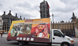 A lorry with a banner protesting against the visit by Mohammed bin Salman, crown prince of Saudi Arabia, drives past the Houses of Parliament.