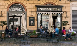 People seated at tables outiside the historical Caffe Al Bicerin in Turin