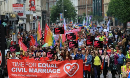 Thousands march in Belfast in favour of same-sex marriage in Northern Ireland.