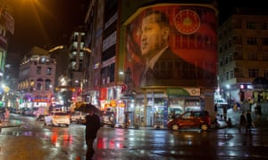 A large image of Recep Tayyip Erdoğan watches over a main street in Rize, Turkey